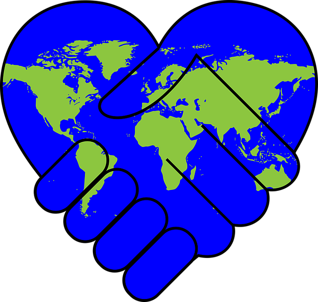 hands holding in shape of heart with globe image on it