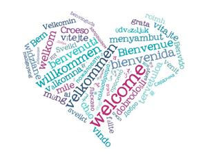 Welcome in many languages in a heart shape