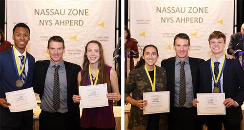 Four award winners, holding certificates, are pictured with the president of the Nassau Zone