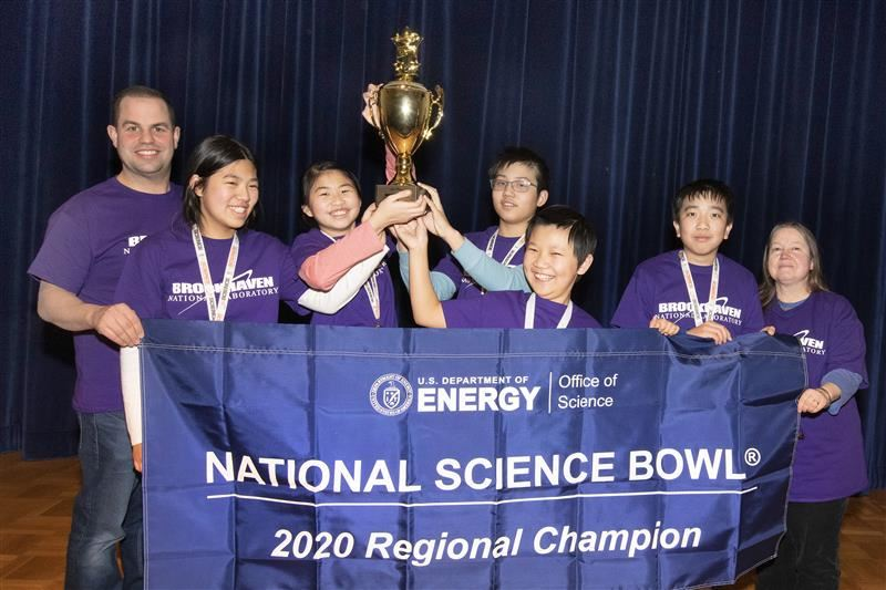 The first-place team from South Middle School holds their Regional Science Bowl trophy and banner.