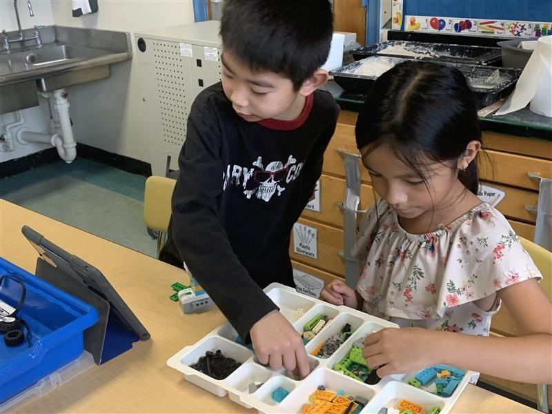 Two students building