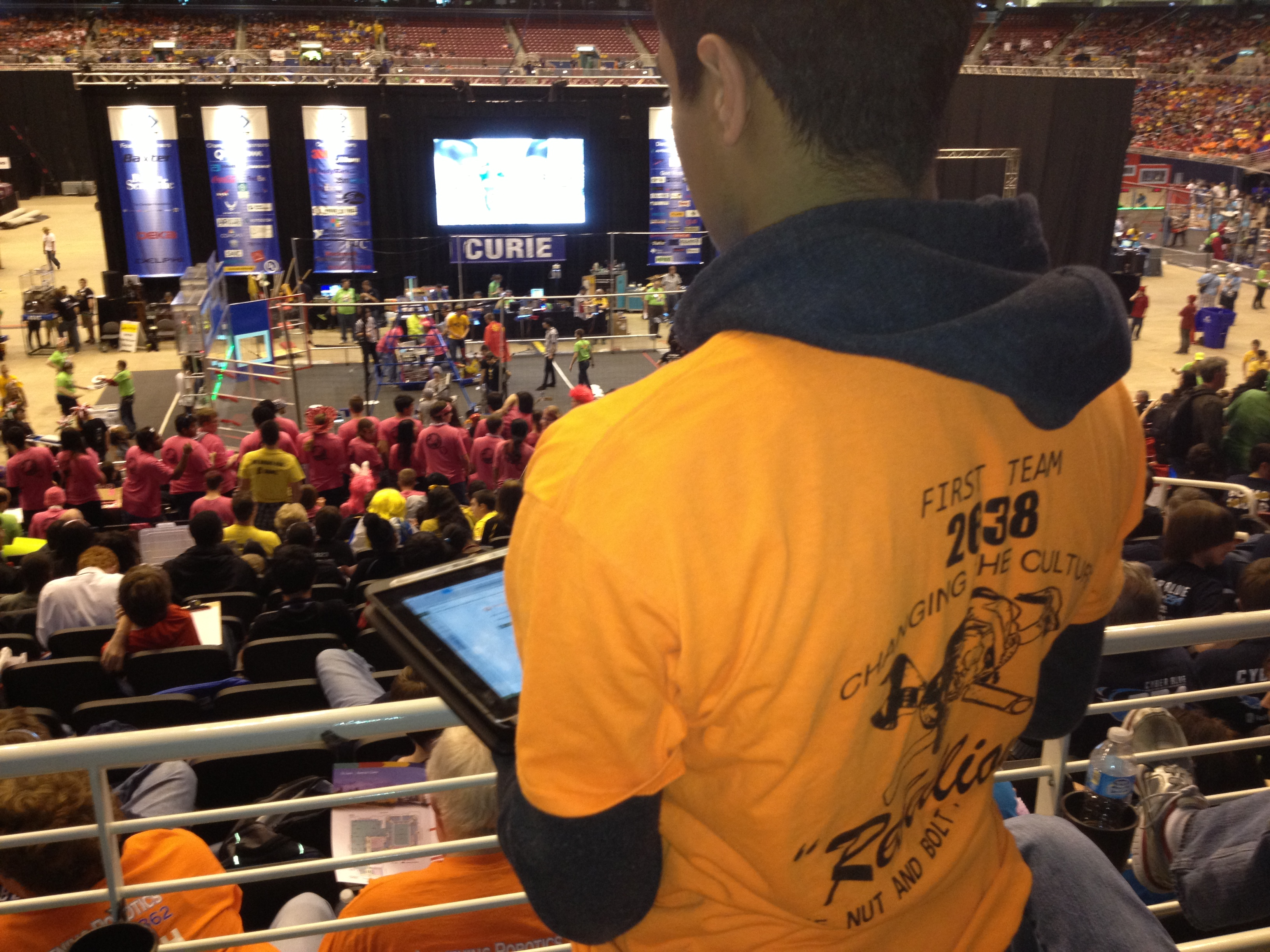 Photo of South High Student with iPad at Robotics Competition